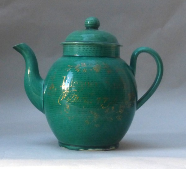 "Green glazed Creamware Teapot and cover,inscribed "" Eleanor Smith Wetheral 1794"""