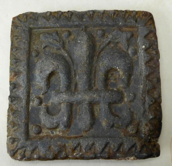 North Devon floor tile Decorated with a Fleur de Lis motif late 17th or early 18th century 5 1/2 inches square