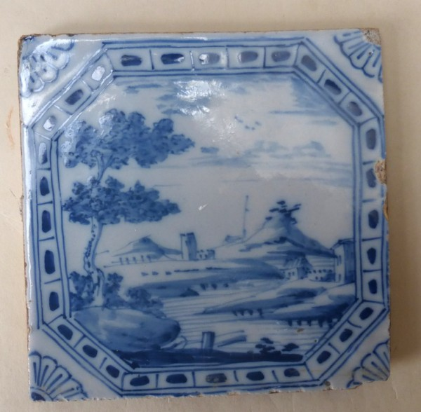 English Delft tile with a framed landscape scene London c1740-60 5 inches square