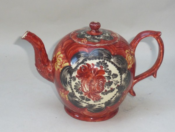 Creamware Teapot and cover with red and black decoration