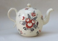 Creamware teapot and cover decorated with a Lady standing in a garden