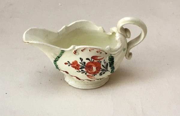 Small Creamware Moulded Sauceboat with Floral Decoration