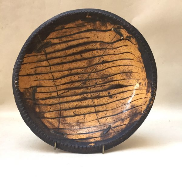 Slipware Dish with Old Staple Repair